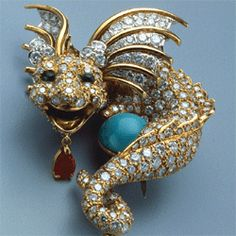 Dragon brooch in platinum, gold, turquoise, diamonds, emeralds and ruby by Donald Clafin, circa 1967
