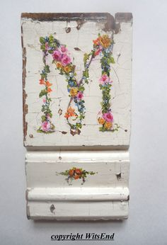 custom order.  Floral monogram on antique wooden plinth block by WitsEnd, via Etsy