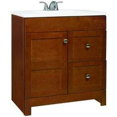 America Classics Artian 30 in vanity.  While the price is a bit high, I think it would be worthwhile to have the additional storage space in our bathroom.