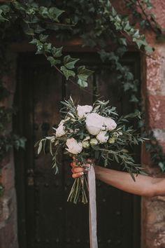 White Bridal Bouquet - Ernesto Villalba Photography   Elegant Outdoor Spanish Wedding with Olive Branches & White Flower Decor   Open The Door Events   Hacienda la Colora Venue