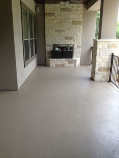 custom painted concrete patio, custom color created to match the stucco, concrete is now stain resistant and easy to clean at Modern Concrete Creations, Austin TX