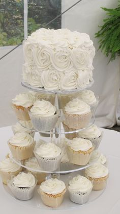 White rosette wedding cake, cupcakes,glittered cupcake wrappers