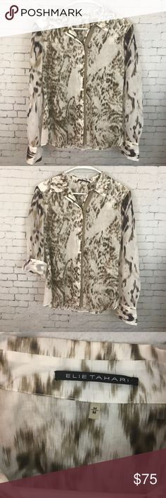 Elie Tahari Celia Blouse Elie Tahari super fine cotton Long Sleeved zip up top. This would be perfect for work or play. Size medium with an abstract animal print. This is such a well made but delicate shirt, it's sure to become one of your favorites. 100% cotton. Dry clean only. Elie Tahari Tops Button Down Shirts