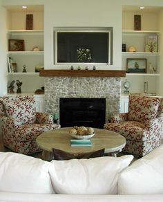 w/shelves and cabinets on each side; TV over fireplace