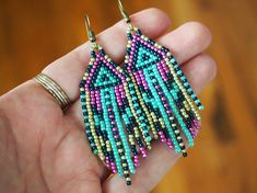 funky fringes in metallic & luminescent summer colors! geometric seed bead earrings. beaded fringe earrings in pink, yellow, and green