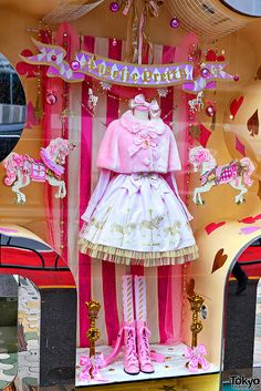 A pretty pink Christmas window display by the Japanese sweet lolita fashion brand Angelic Pretty at LaForet Harajuku.