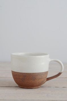 This Dipped Terracotta Cup from Nkuku's Mali ceramic collection is rustic and contemporary. These coffee mugs are hand-made from terracotta clay, half-dipped in glossy white glaze. Pottery Mugs, Ceramic Pottery, Glazes For Pottery, Earthenware, Stoneware, Terracotta, Pottery Studio, Ceramic Clay, Handmade Pottery