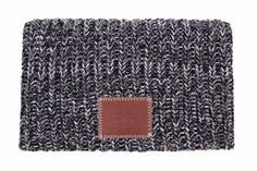 This beanie is knit out of 100% cotton yarn in black, light charcoal, and white colors and features a brown...