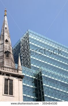 Contrast between old and new and between clerical and profane Old church and modern office building in London, United Kingdom.