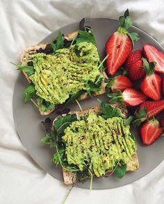 pesto, hummus, greens and avocado on toast + strawberries