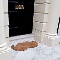Not especially into the moustache craze.  But this is kinda cute.   Moustache Door Mat - Furniture & Decor - Home & Office - Yanko Design