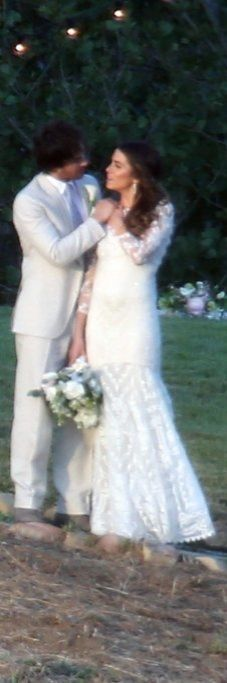 Nikki Reed and Ian Somerhalder Were Perfectly Coordinated on Their Wedding Day, Nikki in a white, lacy three-quarter sleeve gown and diamond drop earrings and Ian in an off-white tuxedo.