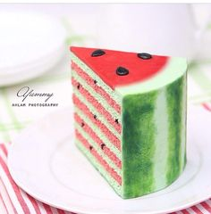 Slice of pink an green stripe watermelon cake