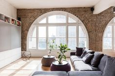 Roof warehouse redesign with beautiful arched windows - CAANdesign