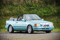 This 'Aquafoam Metallic' Ford Escort Cabriolet has covered no more than miles in 28 years Ford Rs, Ford Sierra, Ford Escort, Old Cars, Classic Cars, Nostalgia, History, Retro, Vehicles