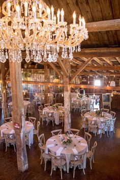 What Could Be Better than a Glam Barn Wedding With a Chandelier? | J. Harper Photography | Elegant Farm Wedding in Pastels and Gold Glitter
