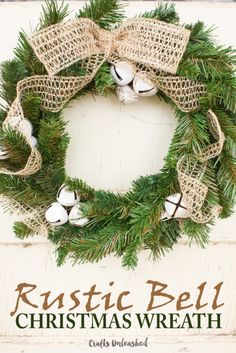 This beautiful rustic bell DIY Christmas wreath is sure to offer a warm welcome to your holiday guests!