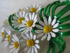 Daisy Cluster Brooch Yellow White Green Enamel Vintage Pin by vintagejewelryalcove on Etsy https://www.etsy.com/listing/239525884/daisy-cluster-brooch-yellow-white-green