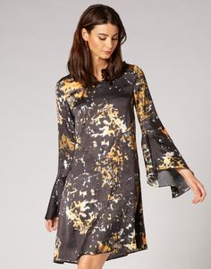 Our unqiue to STORM 'Goldfinger' Print is bound to be a hit! Featuring on trend yellows and golds on a black base, on trend flared sleeves and front panelling, this dress is a must have piece. Style with ankle boots and bare legs while the weather is still warm, or layer over leather look leggings for the cooler months. Panelling, Must Haves, Your Style, Ankle Boots, Cold Shoulder Dress, Weather, Base, Leggings, Legs