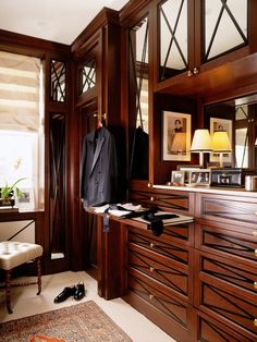 handsomely done... love the dark detail and smoked glass in this men's dressing area