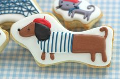 {Parisian doxie decorated cookie} cute & yummy!    This is possibly the cutest thing I've seen all day. It's even cuter than my dachshund.