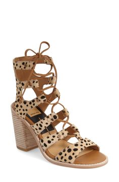 Eye-catching cutouts, leopard print and laces make these sandals standout.