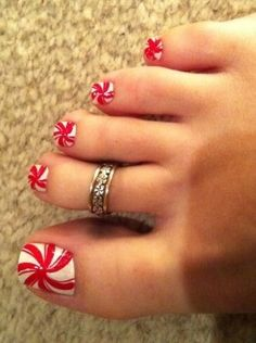 Candy cane toe nails .