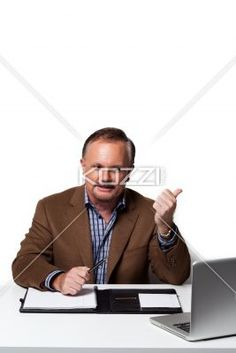 mature businessman at work. - Mature businessman at work looking at laptop, Model: Dan Sanderson