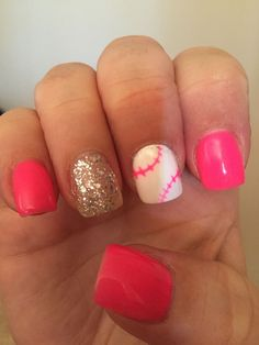 Pink softball nails with glitter.