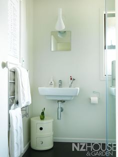 In keeping with the rest of the house, the bathroom was given the Resene 'Black White' treatment; the only piece of furniture is a Componibili modular cabinet by Kartell. Modular Cabinets, Under Sink, Bathroom Humor, Guest Bath, Powder Room, Furniture Decor, Home And Garden, Black And White, Interior Design