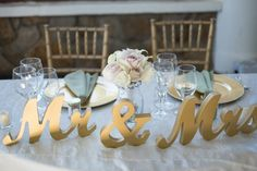OMG!!!!! I LOVE this!!!!!!!  Could use on the TABLE as well as a prop for photos!!!! I'm guessing you can get whatever color you want..... :)  Gold Mr and Mrs Wedding Signs for Sweetheart by ZCreateDesign