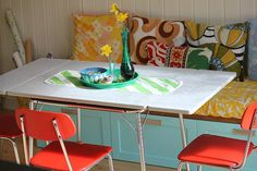 vintage fabric, school house chairs, kitchen cabinets as banquette base, thrifted accessories, and a few cans of paint :)