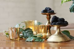 farmhouse table setting with blackberries and gold