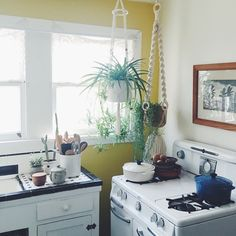 """A magical macrame corner in @heatherfredrck 's Echo Park kitchen. That stove!! And the vegan treats she made were so tasty! Thanks lady!"""