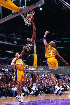 Sam Perkins #14 of the Indiana Pacers dunks the ball against the Los Angeles Lakers on March 3, 2000 at Staples Center in Los Angeles, CA.