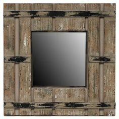 """Wall mirror with a reclaimed wood frame and distressed finish.   Product: Wall mirrorConstruction Material: Reclaimed wood and mirrored glassColor: NaturalFeatures: Distressed finishDimensions: 18"""" H x 18"""" W x 2"""" D"""