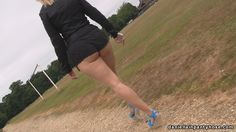 Curvy big bottom British woman out for walk in tan sheer nylon pantyhose tights, booty shorts and blue wedge high heels.