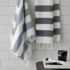 These would match the shower curtains? Feather Grey Striped Hand Towels | west elm