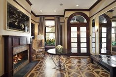 Stunning Entryway With Dark Brown Wooden Contemporary Crown Molding Ceiling With Stone Fireplace And Transome Windows Also French Doors