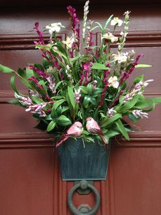 """Pink Wildflower and Bird Wall Pocket Arrangement for Door/Wall/Summer/All Year. Artificial flowers and greens in metal hanging bucket. 21"""""""