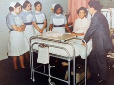 Mr Keith Thomas, Ear, Nose and Throat Consultant carrying out a bedside class to student nurses in the 1970s. NGH