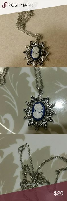 Cameo necklace blue w white face Silver tone Beautifully woman nice cameo sturdy pendent brand new chain approx 20 inches lobster clasp. Brand new   Pendent over 1 inches wide 1 inch talk  Keys vtg wicca Victorian crystals healing cameo woman lady face boutique Jewelry Necklaces
