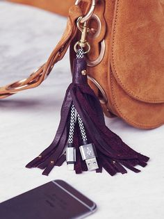 Leather Keychain iPhone Charger at Free People Clothing Boutique #iphonecharger,