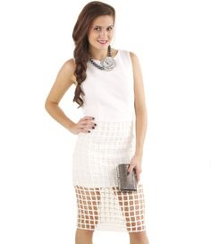 Sleek and sophisticated, this white hot dress features a cool cage cutout at bottom. Comfy stretch fabric and the tank design make it perfect for both day and night; throw on a cropped blazer and heels for that evening look! Fully lined.   By JOA  Polyester/Cotton/Spandex Blend  Dry Clean Only  Imported   Model Info: Height: 5'9"