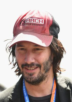 Keanu Reeves Photos Photos - Actor Keanu Reeves walks through the back of the pits during qualifying for the 2016 MotoGP of Australia at Phillip Island Grand Prix Circuit on October 22, 2016 in Phillip Island, Australia. - MotoGP of Australia - Qualifying