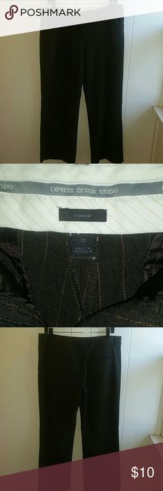 """Express Editor dress pants 10 short. Express Editor dress pants 10 short.  Fabric is charcoal grey with pin stripes. From a distance the striping appears tan but up close it is actually a blend of orange, tan and pink.  Tag says 10 but these were altered to a shorter length, 29"""" inseam. Express Pants Trousers"""