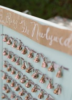 """ring in the newlyweds"" give away bells as a favor and an extra special touch for when the bride & groom depart"