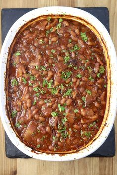 Easy Baked Beans are a must-have for any summer cookout, potluck or family get together. Made with a homemade barbecue sauce and loads of bacon for a the best flavor combination of smoky, savory and sweet. You won't find a tastier version! Best Baked Beans, Baked Beans With Bacon, Pork N Beans, Homemade Barbecue Sauce, Side Dishes Easy, One Pot Meals, Kitchen Recipes, Grilling Recipes, Casserole Dishes