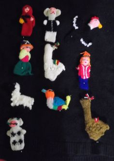 Hand knit finger puppets made with acrilyc wool, knited for peruvian artisans hands(from Puno-Peru)