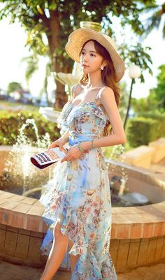 Morpheus Boutique  - Blue Ruffle Low High Chiffon Floral Hem long Dress, $139.99 (http://www.morpheusboutique.com/new-arrivals/blue-ruffle-low-high-chiffon-floral-hem-long-dress/)